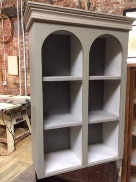 Bookcase with arched tops
